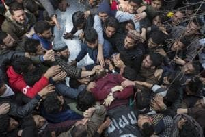 People shout slogans near the body of slain militant Eesa Fazili during his funeral procession in Srinagar on Monday.