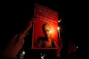 People hold placards and candles during a vigil for Gauri Lankesh, a senior Indian journalist who according to police was shot dead outside her home on Tuesday by unidentified assailants in Bengaluru, in Ahmedabad on September 6, 2017.