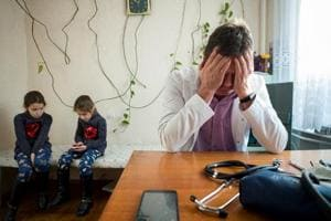 Photos: Ukrainian health care struggles as doctors face resource...
