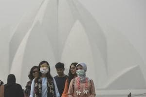 Foreign tourists at the Lotus Temple on a smoggy morning in New Delhi. A Global Burden of Disease report published last year estimated that 1.1 million deaths in India were linked to PM 2.5 air pollution in 2015.