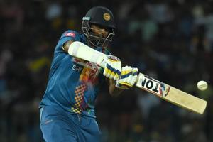 Sri Lankan cricketer Thisara Perera plays a shot during the fourth Twenty20 (T20) international between India and Sri Lanka for the tri-nation Nidahas Trophy at The R. Premadasa Stadium in Colombo on March 12, 2018.