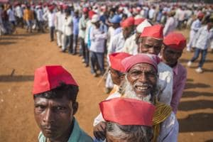 Farmers stand in queue to take free medicines during farmers protest march at Azad Maidan.