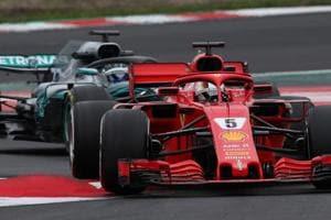 Sebastian Vettel of Ferrari and Valtteri Bottas of Mercedes F1 team during Formula One pre-season testing at Circuit de Catalunya near Barcelona.