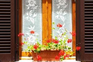 White lace curtains lend an elegant look to the house.