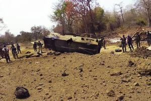 Security personnel inspect the site of an IED blast where nine CRPF personnel were killed in an encounter in Chhattisgarh's Sukma district.
