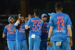 Indian cricketer Washington Sundar (C) celebrates with his teammates after he dismissed Bangladesh cricketer Tamim Iqbal during the fifth Twenty20 (T20) international cricket match of the tri-nation Nidahas Trophy at the R. Premadasa stadium in Colombo on Wednesday.