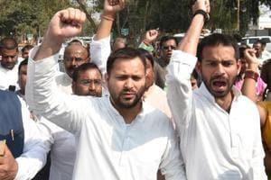 RJD's Tejaswi Yadav (left) and Tejpratap Yadav lead a march by party workers to Bihar Raj Bhawan in Patna.