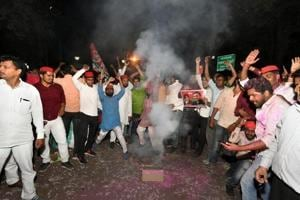 Samajwadi Party supporters celebrate the win in Phulpur and Gorakhpur bypolls, in front of the party office in Lucknow on Wednesday.