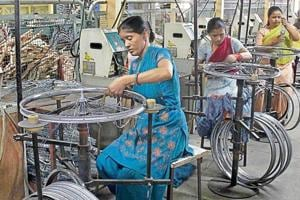 Workers on the job at one of Ludhiana's many cycle manufacturing units, which form a big part of the state's industry.