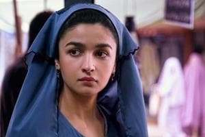 Raazi new look: On her birthday, a burqa-clad Alia Bhatt signals her...