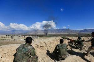 In dramatic escape, Afghan hostage grabs gun as Taliban captors pray,...