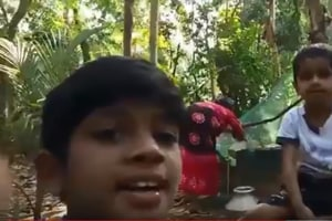 Screengrab from the clip of the child taking a selfie video while his grandmother draws water from a well.