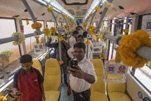 People take selfies inside the newly-launched buses.