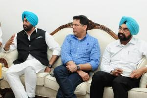 AAP leader Sukhpal Singh Khaira (left), MLA Aman Arora (centre), and MLA Kanwar Sandhu at the AAP Punjab MLAs meeting in Chandigarh on Friday.
