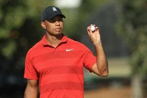 Tiger Woods continues to rise in FedEx Cup, world golf rankings