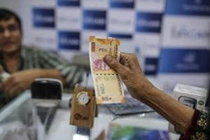 Rupee falls 4 paise against US dollar, hits four-month low