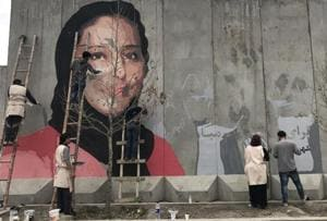 Provocative graffiti campaign depicts people killed by Afghan warlords...