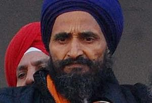 Sikh activist Gurbaksh Singh Khalsa jumps off water tank in...