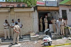 Police personnel at Maruti courier where blast took place at Ahmednagar near Pune.