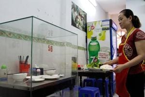 Vietnam restaurant encases table where Obama enjoyed noodles, attracts...