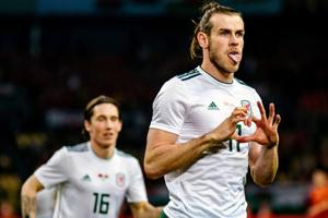Gareth Bale becomes Wales' record goalscorer, guides team to 6-0 win...