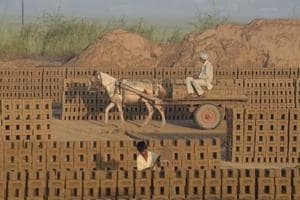 A labourer transports bricks on a cart in a brick kiln on the outskirts of Jalandhar.  Brick kilns are found clustered around big metros like Delhi, Chennai, Kolkata, Pune, Ahmedabad, Hyderabad, Kanpur and Patna feeding a construction boom