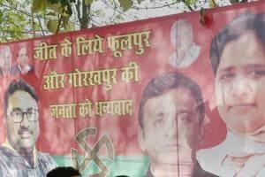 A poster of Bahujan Samaj Party supremo Mayawati and Samajwadi Party chief Akhilesh Yadav outside the Samajwadi Party's office in Lucknow.