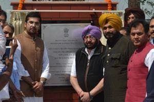 Chief minister Capt Amarinder Singh, local bodies minister Navjot Singh Sidhu and others during the inauguration of the martyrs' museum at Khatkar Kalan in Nawanshahr on Friday.