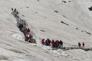 Sikh pilgrims passing through the glaciers to reach the Hemkund Sahib Gurudwara in Uttarakhand.