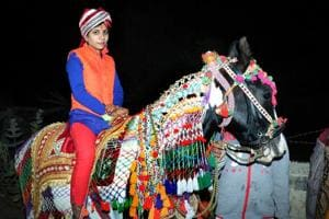 Sarita Thalor rides a mare, a day before her wedding, at Phagalwa village in Sikar district.