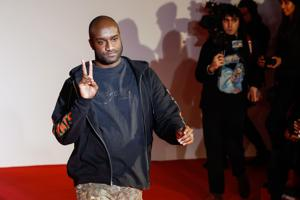 US fashion designer Virgil Abloh acknowledges applause following the presentation of the men
