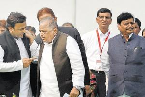 Cracks had emerged in ties between Shivpal (far right) and Akhilesh (left) in August 2016, when a power struggle broke out in the family.