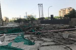 A scaffolding at a housing construction site collapsed in Noida's Sector 121.