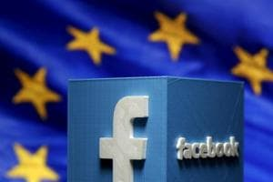 A 3D-printed Facebook logo is seen in front of the logo of the European Union.