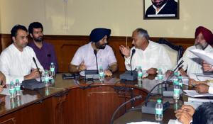 Mayor Sanjeev Sharma Bittu (second from right) addressing the General House meeting at the municipal corporation office in Patiala on Monday.