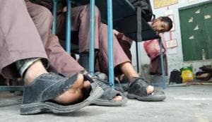 With shoes worth Rs 266 cr in tatters, UP kids walk 'barefoot' to...