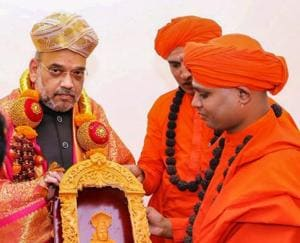 BJP president Amit Shah being presented with a souvenir on his visit to Madara Chennaiah Swamiji mutt, during his state tour ahead of Karnataka elections in Chitradurga on Tuesday.