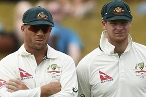 Steve Smith and David Warner have been banned from all international and Australian domestic cricket for 12 months by Cricket Australia (CA) following their roles in the ball-tampering scandal that has overshadowed their country's Test series against South Africa, while Cameron Bancroft (not in pic) has received a nine-month suspension.