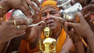 Devotees of Digambar Jain community perform rituals on a statue of Lord Mahavira on the occasion of Mahavir Jayanti.