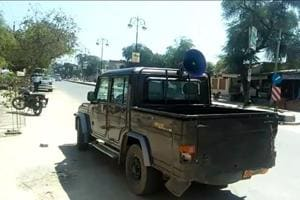 """The vehicle with loudspeaker making announcement of """"heavy discount"""" on liquor, in Talwandi Sabo, 30km from Bathinda, on Friday."""