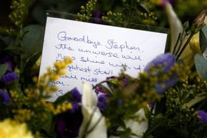 A floral tribute left outside Great St Marys Church, where the funeral of theoretical physicist Prof Stephen Hawking is being held, in Cambridge, Britain on  March 31.
