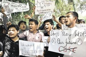 Students protest against the CBSE decision to hold retests, near Jantar Mantar in New Delhi recently.