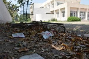 The lawn at the community centre, Sector 12A, with leaves, garbage scattered around.