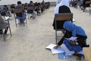 Afghan woman who took exam with baby on lap enrolled at private...