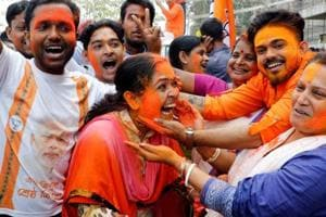 Bharatiya Janata Party supporters celebrate after the party's win in Tripura assembly elections, in Agartala, on March 3.