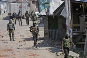 Army soldiers during a gun battle between militants and security forces in Shopian, South Kashmir, on Sunday.