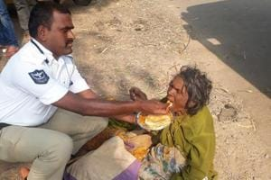 The image has garnered praise for B Gopal and his humane action.