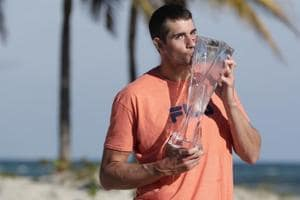 John Isner won his first Masters title at the Miami Open on home soil, producing a brilliant display of serving to beat Alexander Zverev.