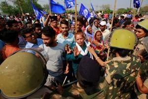 8 killed in Dalit protests, govt moves SC to protect SC/ST Act as...