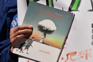 An anti-nuclear protester holds best-selling children